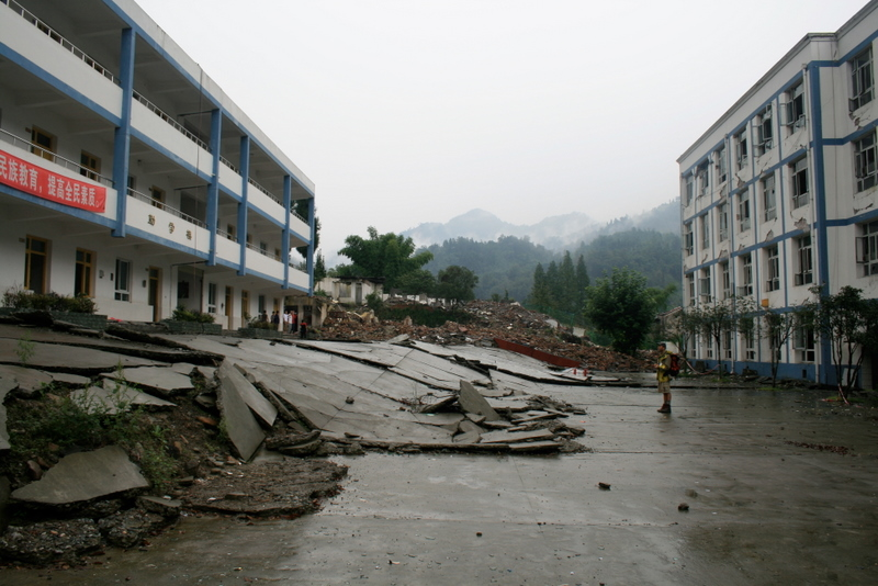 Figure 3: Fault scarp that formed in the courtyard of Bailu Middle School during the 2008 Wenchuan earthquake. The school buildings were less than one year old at the time of the earthquake and did not collapse. It is possible to save people's lives.