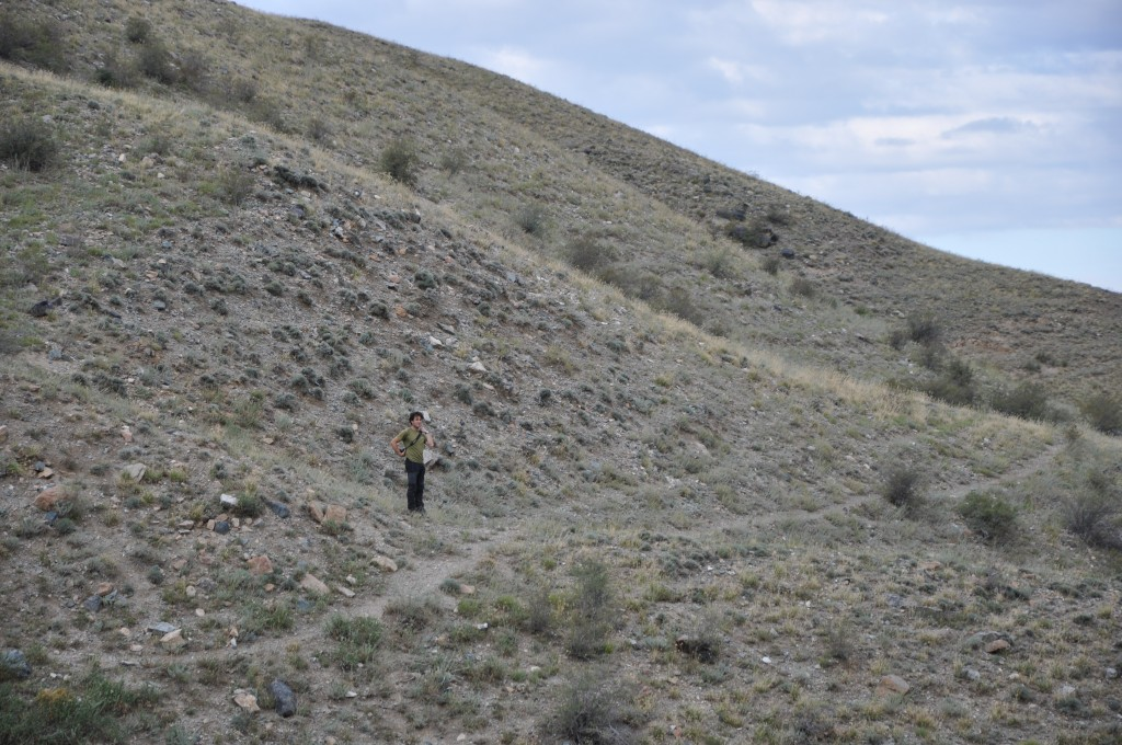 David Mackenzie stands in front of the fault scarp.