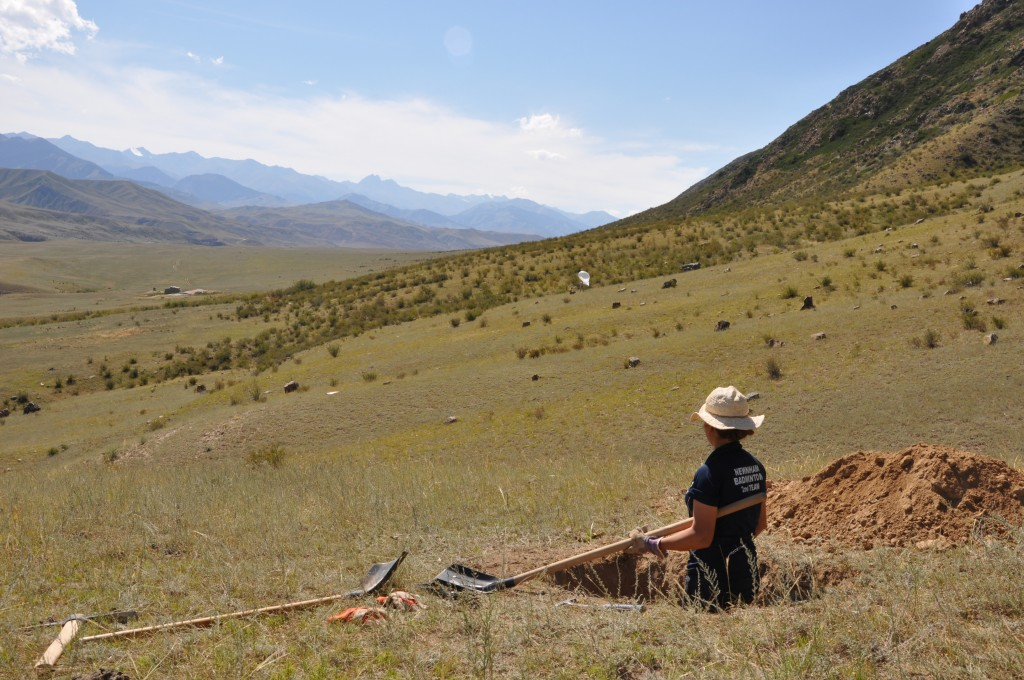 Eleanor Ainscoe excavating the sample pit.