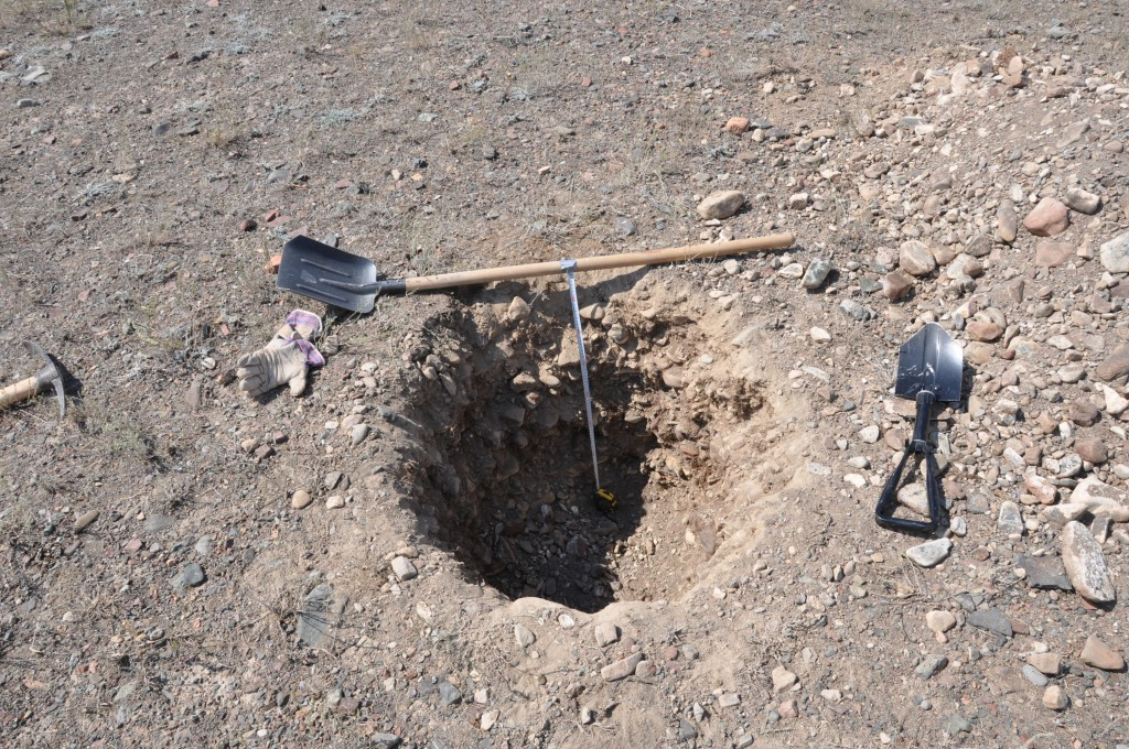 A hand-dug sampling pit.
