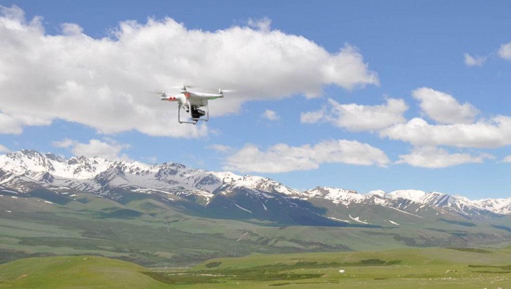 A small, battery-powered drone with an attached compact camera on it sflight across a fault scarp in Kyrgyzstan.