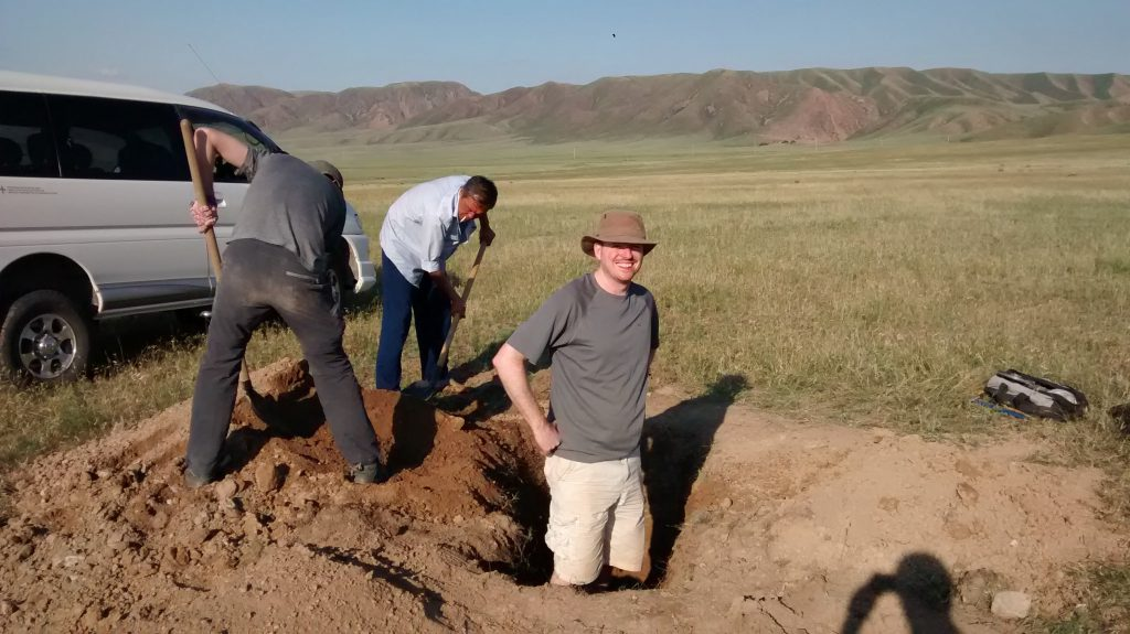 Digging pits to sample and date the alluvial fans.